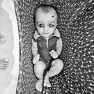 baby in the thar desert rajasthan india by Heather Buckley