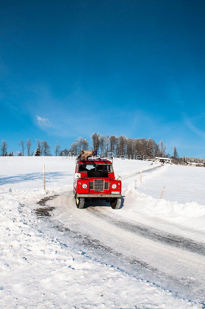 Bright red firetruck in the snow by Michael Brewer