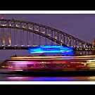 Sydney Harbour at night with long exposure ferry by kathybellingham
