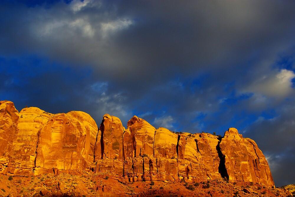 Last sunlight on rock wall by Claudio Del Luongo