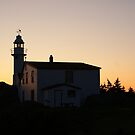 Sunset, Lobster Cove Head Lighthouse by Jean Knowles