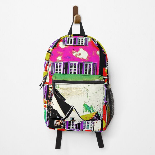 Colorful apartment buildings during day time Backpack