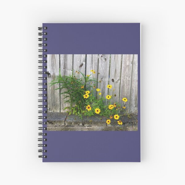 Yellow Flowers on a Gray Fence Spiral Notebook