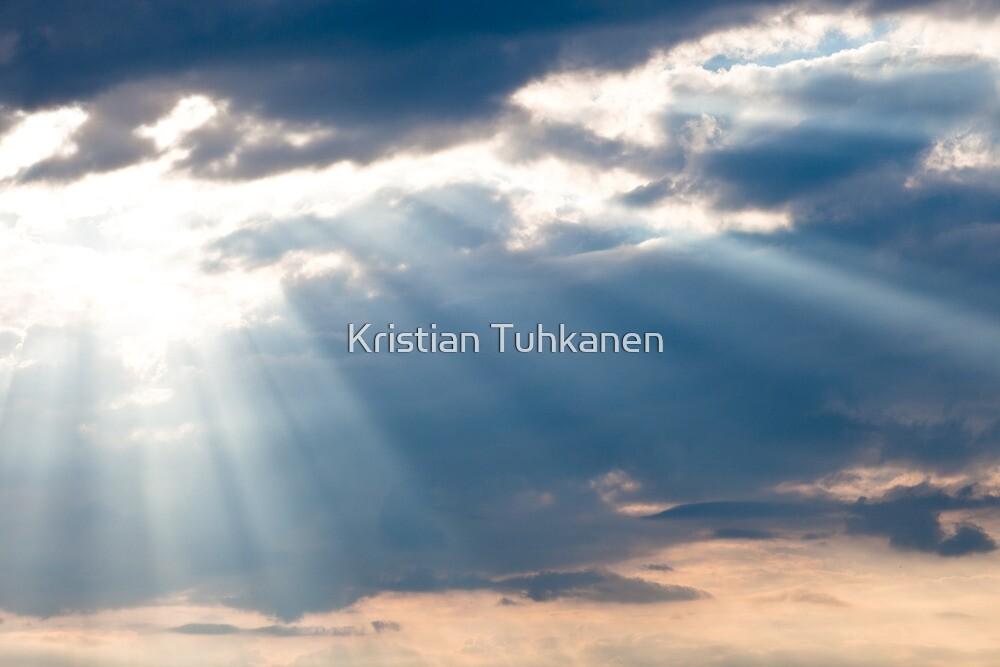 Sun shining thru clouds by Kristian Tuhkanen