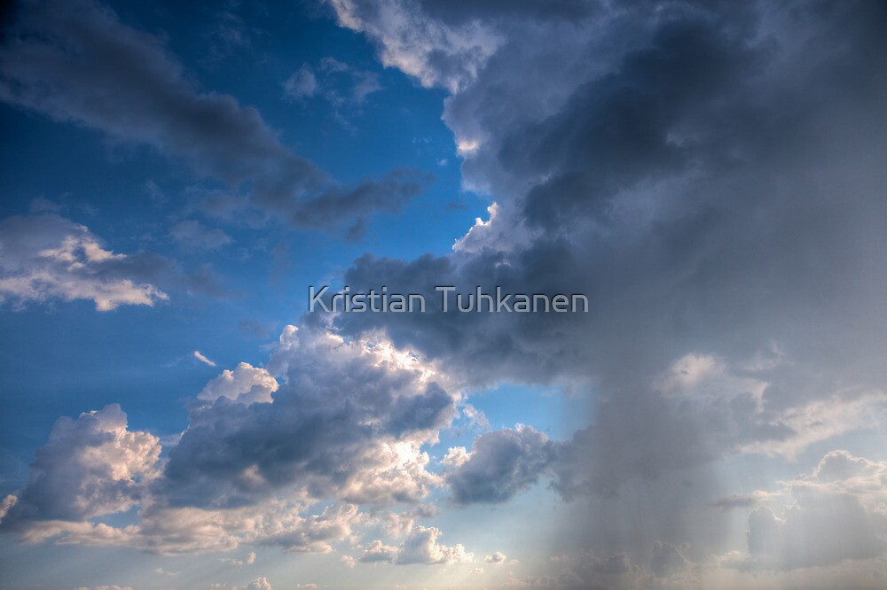 Raining clouds with rays of light shining through by Kristian Tuhkanen