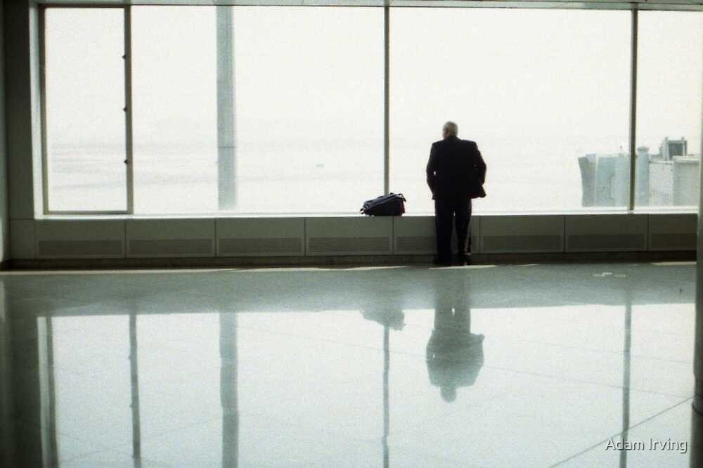 Man at Beijing airport by Adam Irving