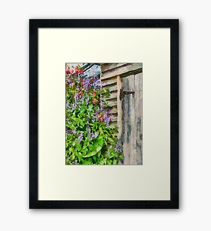 Flowers by the barn door Framed Print