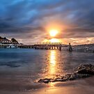 Light above the jetty by Adriano Carrideo