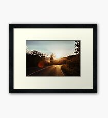 Road at sunset Framed Print