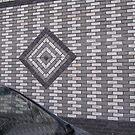 Brick wall and car mirror  by Smaragd