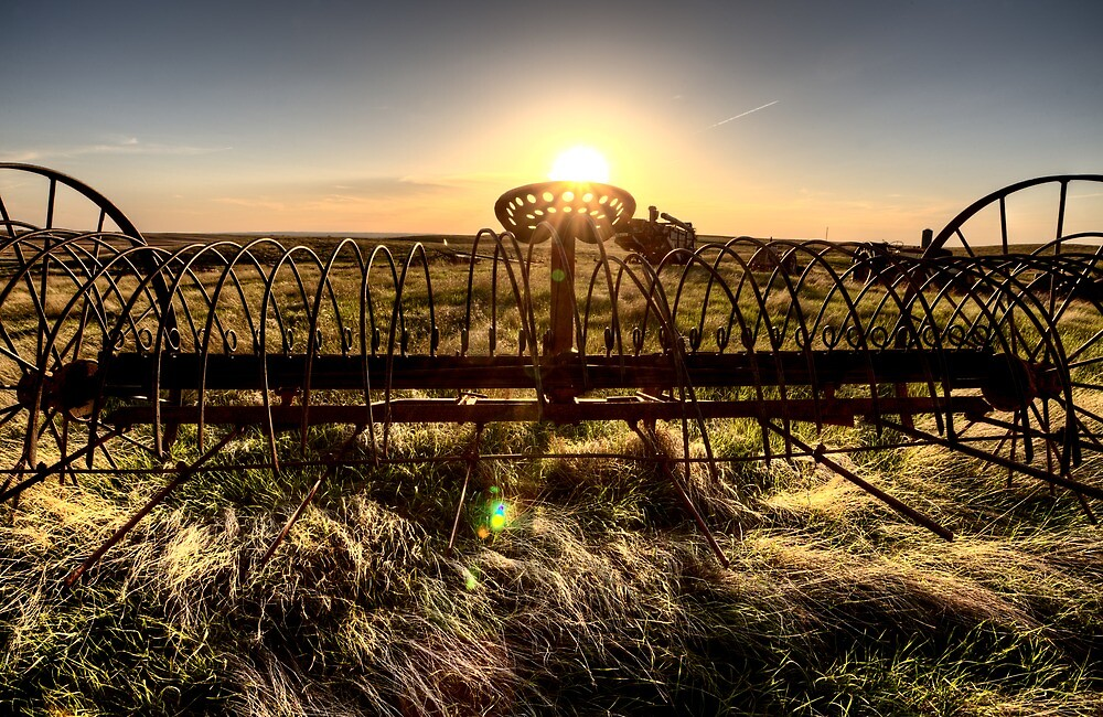 Antique Farm Equipment sunset Saskatchewan Canada by pictureguy