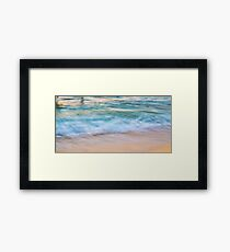 Waves meets sand Framed Print
