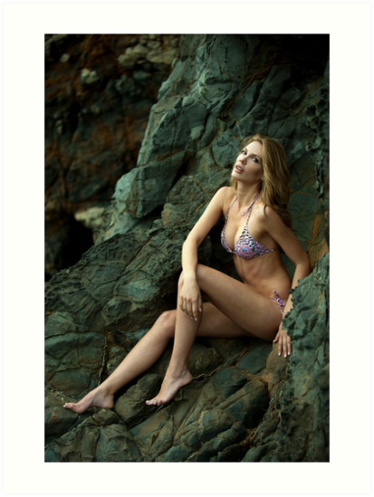 Bikini model posing in front of rocks in Palos Verdes, CA by Anton Oparin