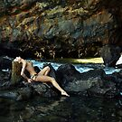 Topless model posing in front of rocks in Palos Verdes, CA by Anton Oparin