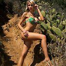 Bikini model posing in front of kaktus field in Palos Verdes, CA by Anton Oparin