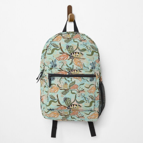 Madagascar Floral has butterflies and dragonflies with peach, orange and teal colors.  This color palette matches with my Chameleon design. Backpack