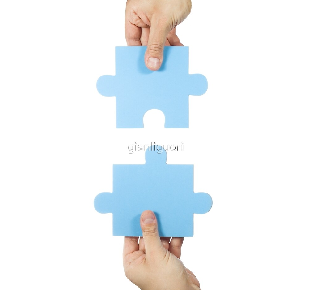 Two hands connecting puzzle pieces by gianliguori