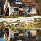 Old house with reflection in water photo by Mario Cehulic