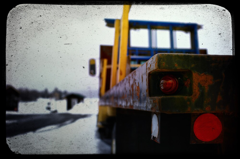 Flatbed TailLights in a Parking Lot by Nazareth