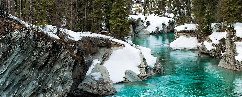 Winter stream in the mountains by camfischer