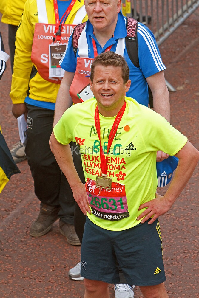 Mike Bushell  BBC presenter poses with his london Marathon medal by Keith Larby