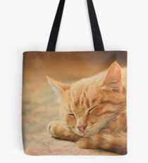 Little Red Kitten Sleeping On Bed Tote Bag