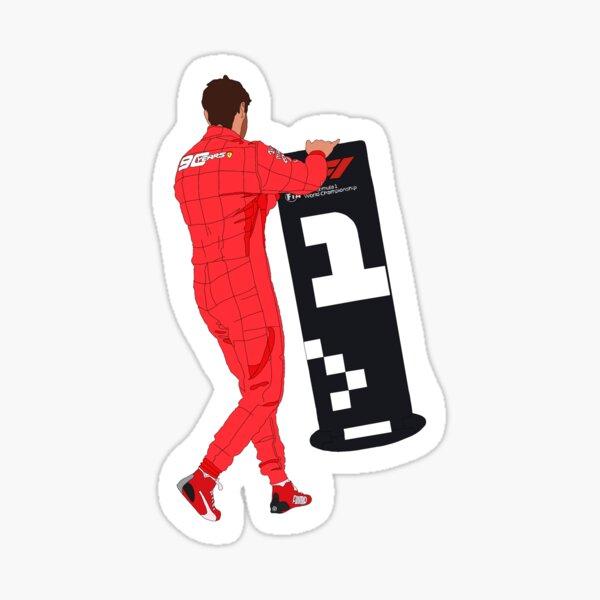 Ferrari-Fahrer Sebastian Vettel bewegt das # 1-Zeichen Sticker