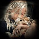 Girl cuddles Rabbit by Manfred Belau