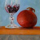 pomegranate and glass of red wine on a book by Jeremy Wallace