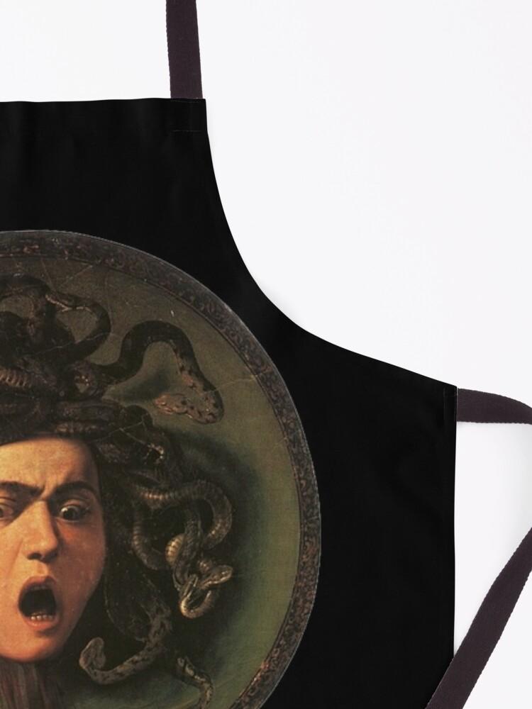 Alternate view of Medusa. Gorgon. Venomous snakes in place of hair. Monster. Greek Mythology. Michelangelo, Caravaggio. on BLACK. Apron
