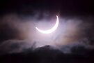 Crescent Sun between the Clouds by Richard Heath