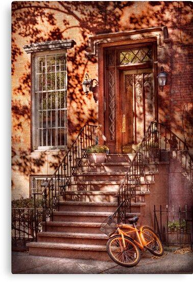 Bike - NY - Greenwich Village - An orange bike  by Michael Savad