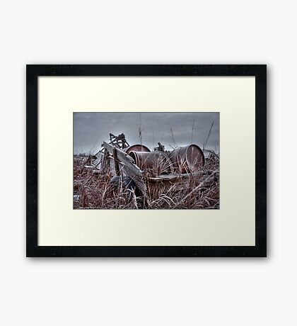 Old wagon in field Framed Print