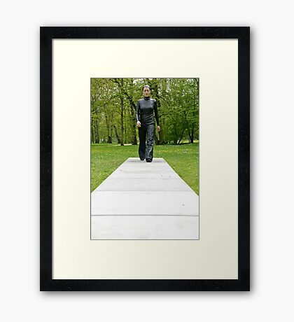 A walk in the park (Walking Woman by Sean Henry) Framed Print