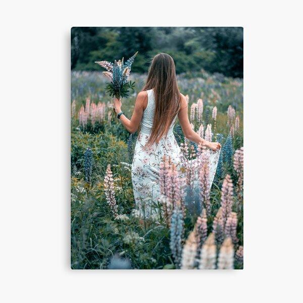 Girl in dream-line lupine flower foe;d Canvas Print