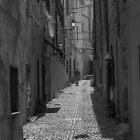 A backstreet in Alghero Sardinia. by naranzaria