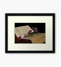 book and rose Framed Print