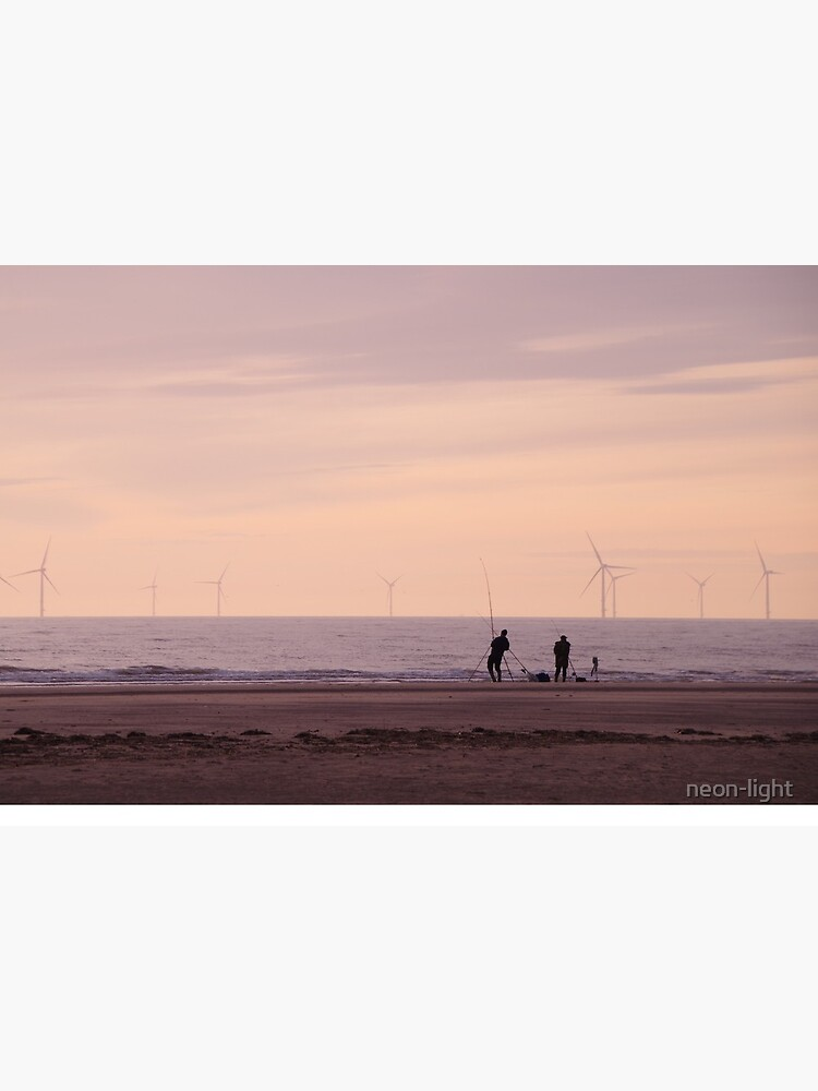 Pulling in the catch as the Sun Sets in Hoylake by neon-light