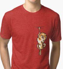 Clingy Orange Pomeranian Tri-blend T-Shirt