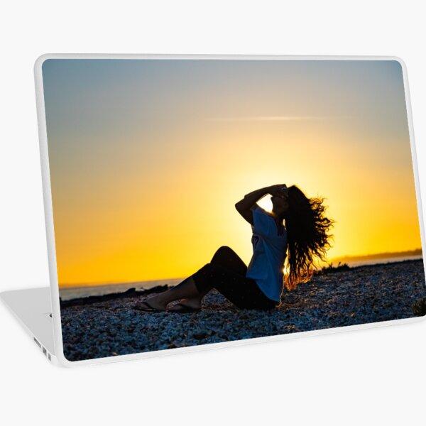 Enjoying the sunset Laptop Skin