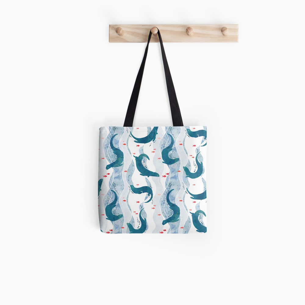 Swimming otters in blue Tote Bag