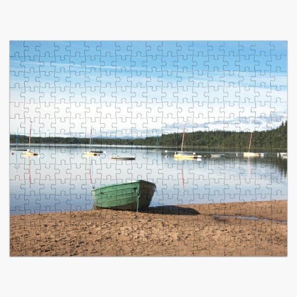 Tranquil loch with a green boat Jigsaw Puzzle