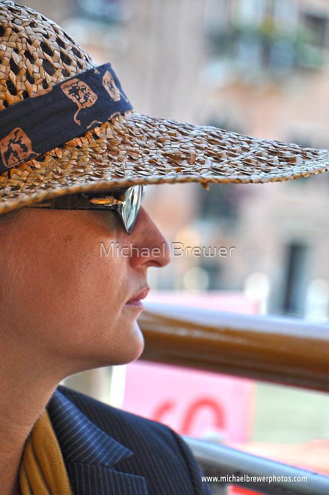 Woman in a straw hat in Venice by Michael Brewer