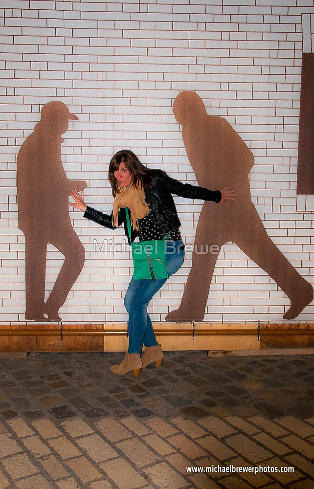 Posing with wall art in Ravenna by Michael Brewer
