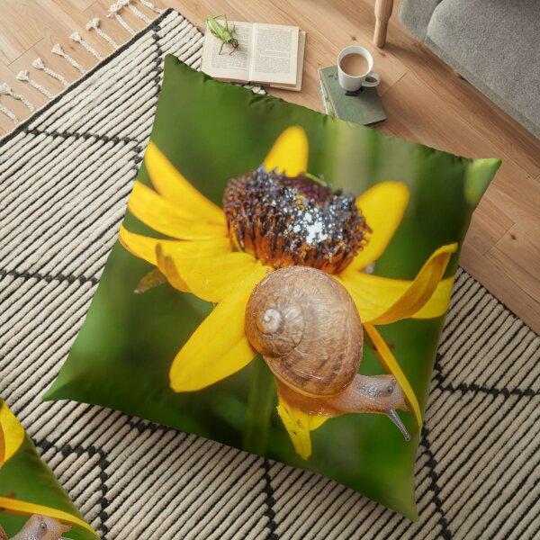 Snail eating a flower Floor Pillow
