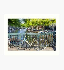 Amsterdam canal and bikes Art Print