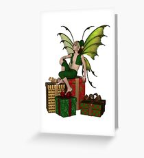 Christmas Fairy Elf Boy Sitting on a Pile of Presents Greeting Card