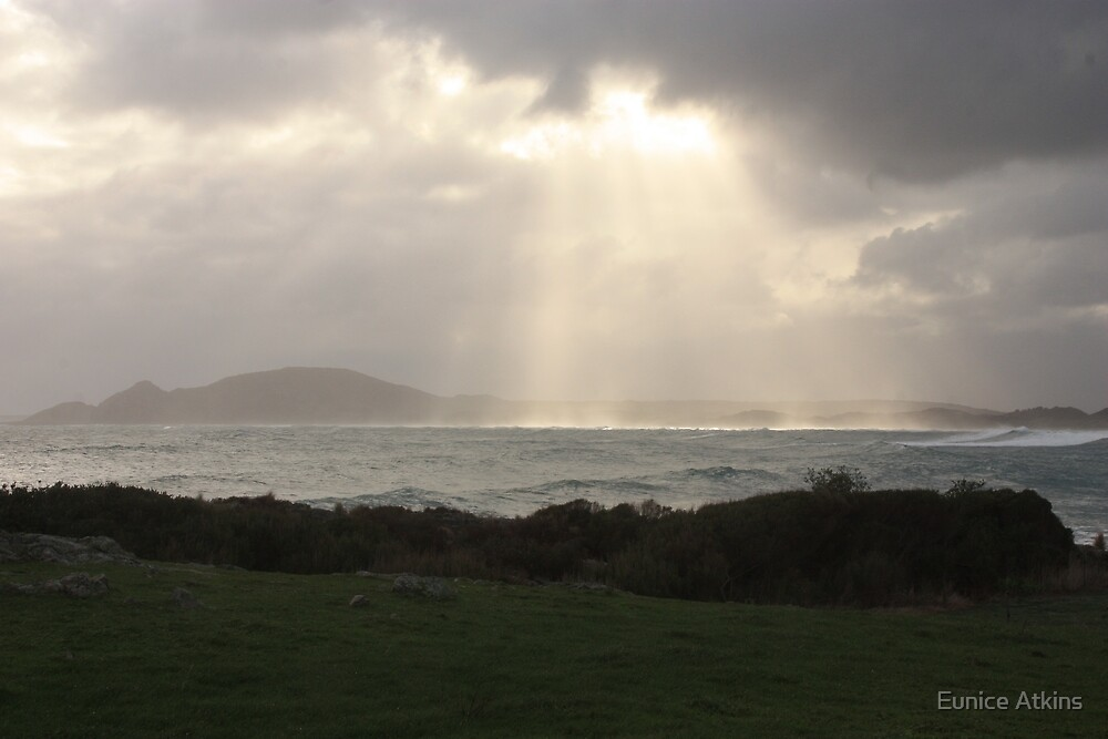 Sun breaks through the stormy clouds by Eunice Atkins