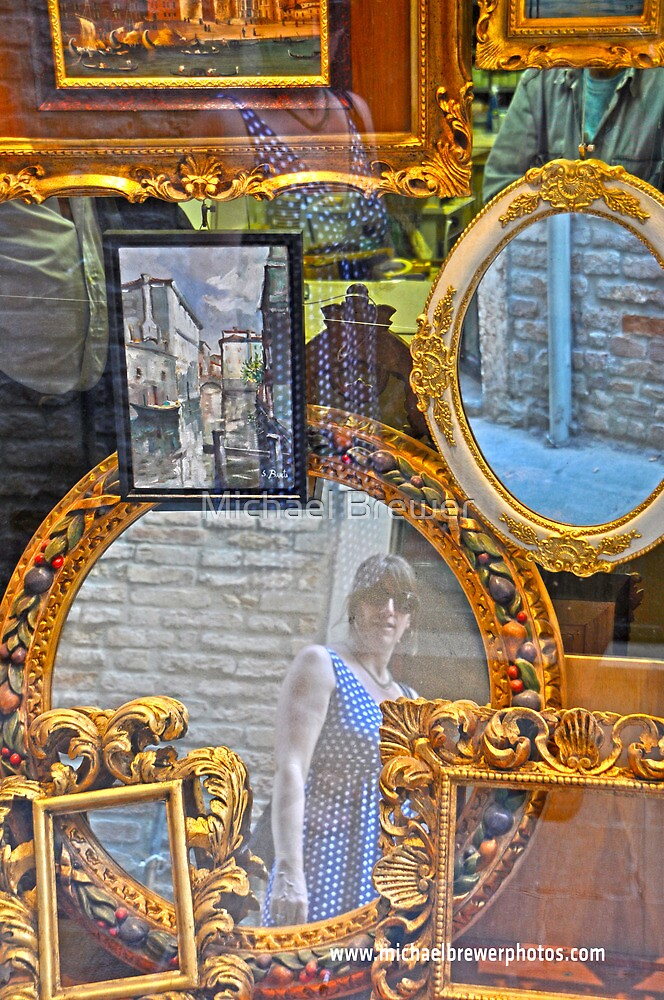 Reflections in a frame shop window by Michael Brewer