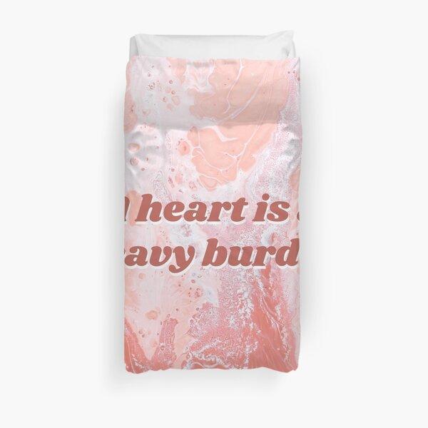Un cœur est un lourd fardeau Housse de couette